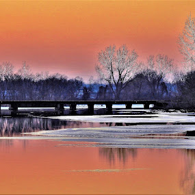 Bridge Over Peaceful Water by Kathy Woods Booth - Buildings & Architecture Bridges & Suspended Structures ( reflections, waterscape, dusk, sunset, bridge, mirrored reflections, peaceful, sundown )
