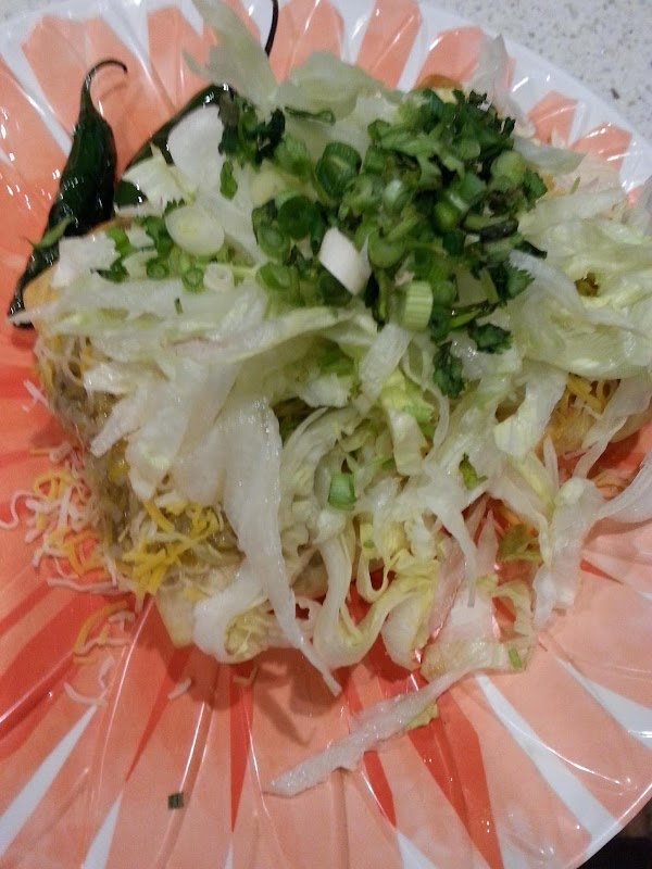 Top more with shredded lettuce, cilantro, green onion, your favorite salsa and sour cream.