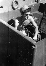 Photo: POF/PSF/PT109-1   Lt.(jg) John F. Kennedy aboard the PT-109 in the South Pacific, 1943. Photograph in the John F. Kennedy Presidential Library and Museum, Boston.