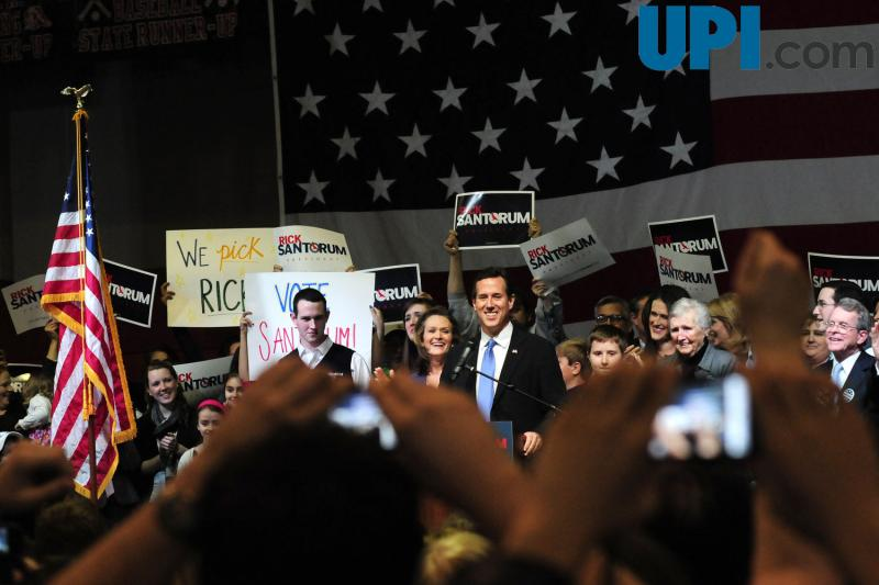 Photo: Cell phone cameras rise above the crowd as Republican presidential hopeful Rick Santorum addresses his supporters at the Super Tuesday Election Night Party in the gymnasium of the Steubenville High School in Steubenville, Ohio March 6, 2012. UPI/Archie Carpenter