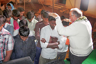Photo: Praying for those who responded for salvation the second night at the same village.