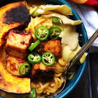 Peanut-Miso Ramen Noodles with Spicy Tofu, Kabocha, and Wild Mushrooms.