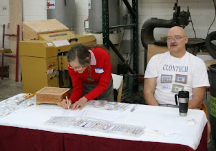 Photo: Margaret Follas and Don Van Ryk staffing the pen sales table.
