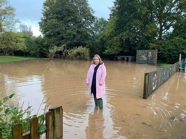 Cllr Jess Bailey at the flooded Tipton St John Primary School