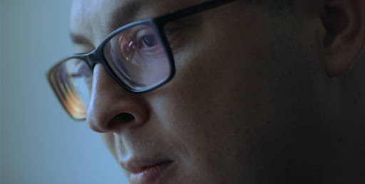closeup of a man with spectacles