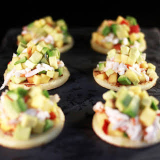 Avocado Tartare with Crab and Yellow Peach on Crepes.