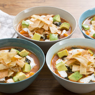 Pinto Bean & Winter Squash Soup with Aged Cheddar Cheese & Crispy Tortilla Strips.