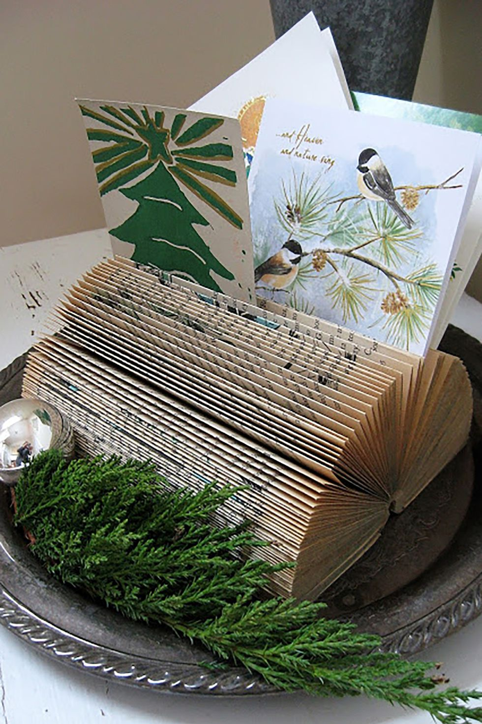 Book Card Holder: These 25 DIY Christmas Card Holders - That Double As Festive Decor will allow you to beautifuly display your cards and will also give you some great decor.