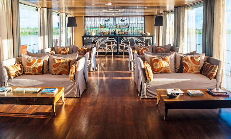 Indoor bar and lounge on the Aria Amazon cruise ship.