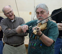 Photo: Ed plays the fiddle whose body he turned, hollowed, and halved