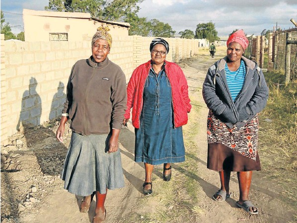 Nomakhwezi Mthizana-Base, flanked by Nobelungu Lumkwana and Lindiswa Mbiko, are three of seven women whose homes in Zimbane are under threat from a traditional leader and her committee.
