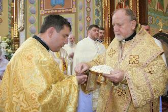 Photo: Владика Михаїл роздає Тіло Христове