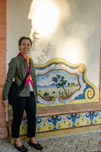 Photo: Florine, beside painting on wall in the courtyard.