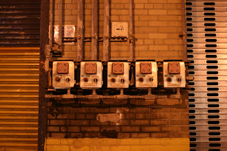 Photo: Electrical equipment on a pier building along the Hudson River.