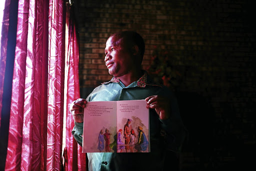 Gelozi Munyeni, a San of Platfontein, Northern Cape, with a book written in his language