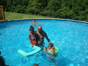 Photo: uncle Leonard helps the girls in the pool