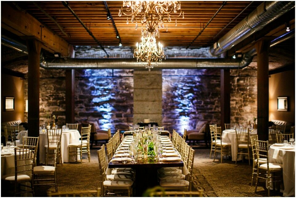 small wedding venue dinner space with blue lighting up the wall