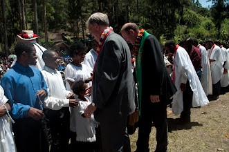 Photo: Rev. Dr. Tim Quill and Rev. John Mehl congratulating the newly baptized members of the Gutnius Lutheran Church in Papua New Guinea.