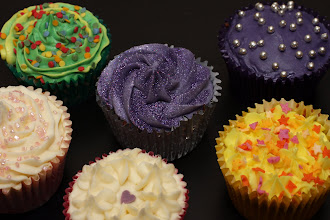 Photo: A selection of decorated cupcakes