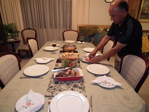 Photo: Noel laying out the dinner table for us at his beautiful home!