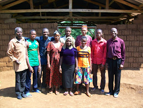 Photo: All those baptized in December, along with Pastor Eugene (far right) and Brother Tomasmike (blue shirt).