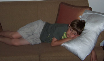 Photo: Sebastian asleep on the couch on our first night at the Sheraton Vistana Resort Villas