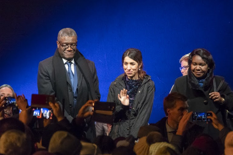 Nobel Peace Prize laureates Congolese doctor Denis Mukwege and Yazidi activist Nadia Murad arrive at the Nobel outdoor concert in front of the Oslo Town hall on December 9, 2018 in Oslo on the eve of the Peace Prize ceremony.