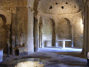 Photo: Behind the Church is the Baptistry, one of the oldest religious sites in France. It dates from the 6th century, and used as its foundation an older Roman temple. The hollow on the floor marks the location of the baptismal font.