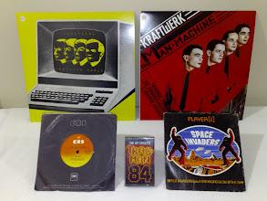 Photo: LPs Kraftwerk Computer World, Kraftwerk The Machine. 45's Mi-sex Computer Games, Player[1] Space Invaders, A Menacing Glow in the Sky Cassette Trac-Man 84