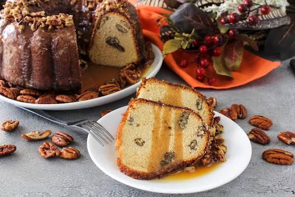 Slices Of Caramel Pecan Pound Cake With Caramel Sauce On Top.