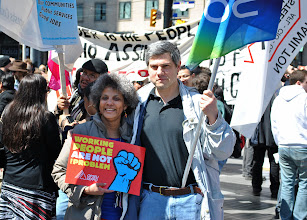 Photo: Members of OPSEU pose for a picture at Yonge/Dundas Square in Toronto.