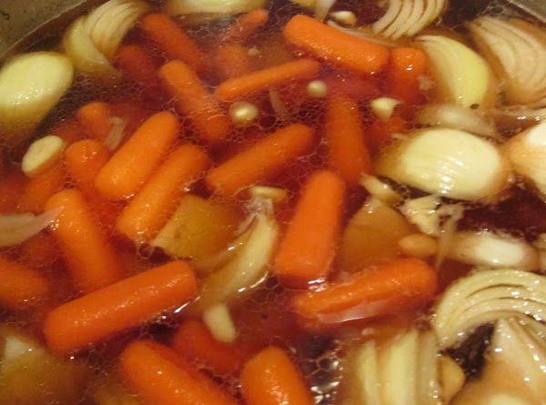 While corned beef is baking in oven cook the remaining vegetables. Add onions, garlic...