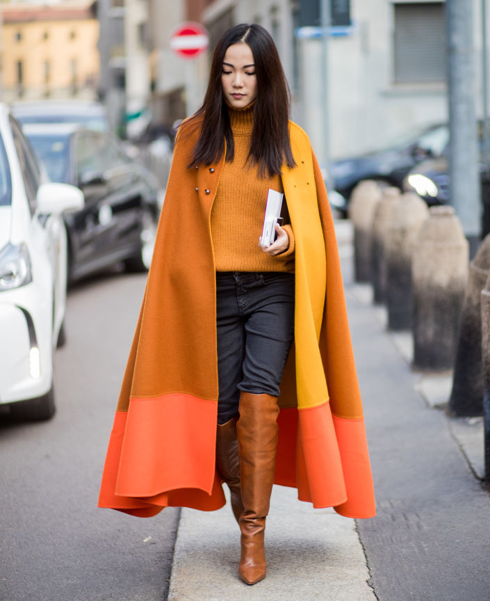 Add a splash of colour to your outfit by opting for a bright two-tone cape