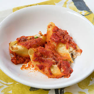 Crab Stuffed Shells With Creamy Tomato Sauce.