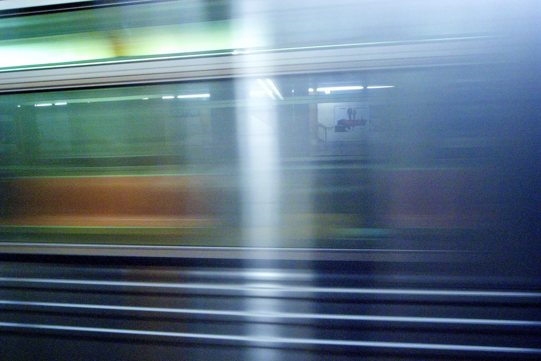 Photo: The F train speeds through the Jackson Heights station.