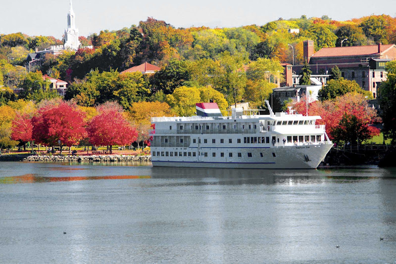 The diminutive American Star docks at a town on the Hudson River featuring colonial architecture as the leaves begin to turn.