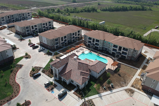 Overhead shot of the apartment buildings and pool