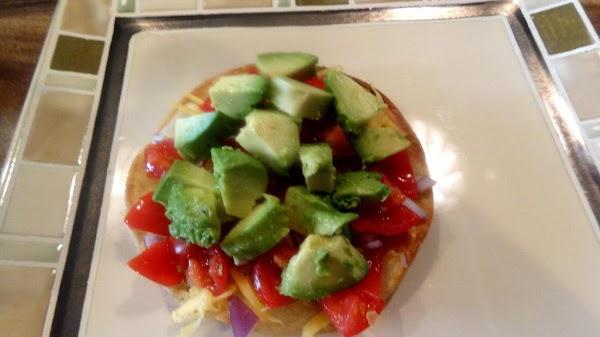 Add half the diced avocado.