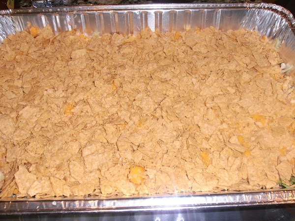Right before serving, add cheese and crushed tortilla chips on top.  Enjoy