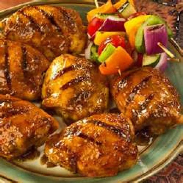 Grill chicken over medium coals 12 to 15 minutes until tender and no longer...