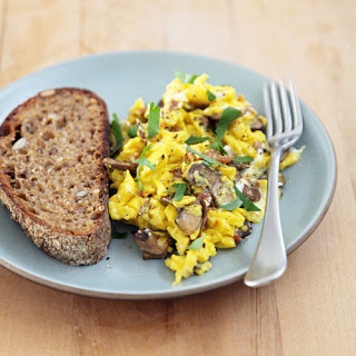 Scrambled Eggs With Wild Mushrooms, Sun-Dried Tomatoes, and Goat Cheese