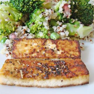 Quinoa Salad with Fried Tofu, Broccoli and Peas.