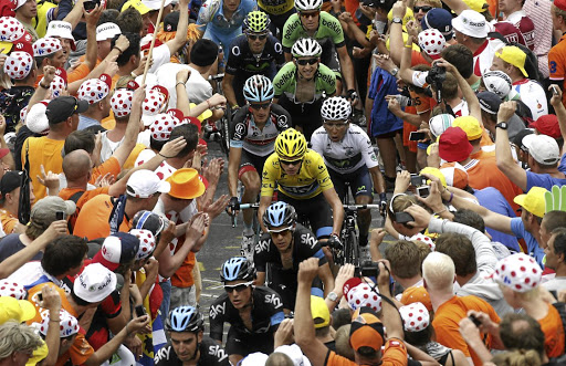 Crowds close in on riders, including yellow jersey holder Chris Froome, on the Alpe d'Huez climb at the 2013 Tour. Picture: REUTERS
