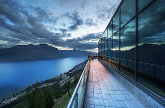 Photo: Above the World - High up in Queenstown, New Zealand   There is a gondola ride that goes to the top of one of the mountains in Queenstown. It's not one of the ski areas -- just an area for hanging out, seeing the sites, the luge, dinner, and this sort of thing.  But it's always stunning.  I went up there a few times.  They have one of those giant buffet dinners up there where I took the family.  It's one of those high-end ones where you try a little bit of everything and then realize that you are way too full and bloated...  I tried to shake off the guilt by running outside at dusk to take this photo!  from the blog www.stuckincustoms.com