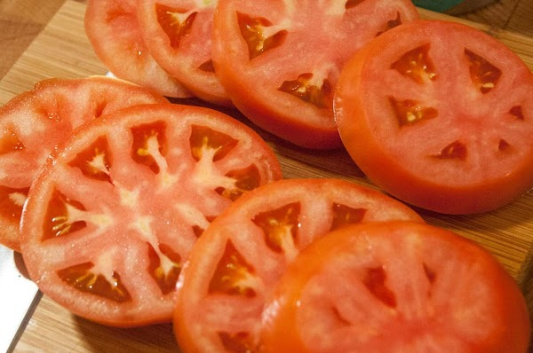 Thickly slice the two tomatoes.