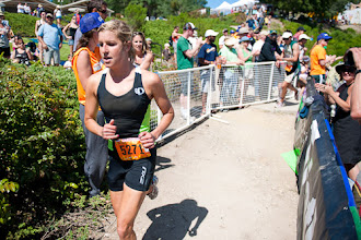 Photo: Liz Johnson came out of T2 in 3rd, but ran sub 39 minutes to take the win.