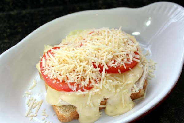 If using slices of ripe tomato, add now. Sprinkle with Parmesan cheese.