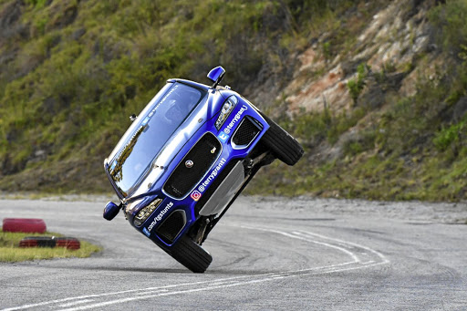 Famous international stunt driver, Terry Grant, drove the entire hillclimb route with with the Jaguar E-Pace on just two wheels. Picture: MOTORPRESS