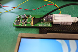 Photo: Third revision of the driver board. Very proprietary DP->eDP 1:1 connection.
