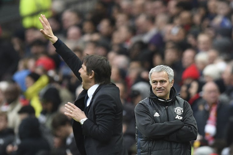 Manchester United's Portuguese manager Jose Mourinho (R) looks on as Chelsea's Italian head coach Antonio Conte (L) gestures during the English Premier League football match between Manchester United and Chelsea at Old Trafford in Manchester, north west England, on April 16, 2017.
